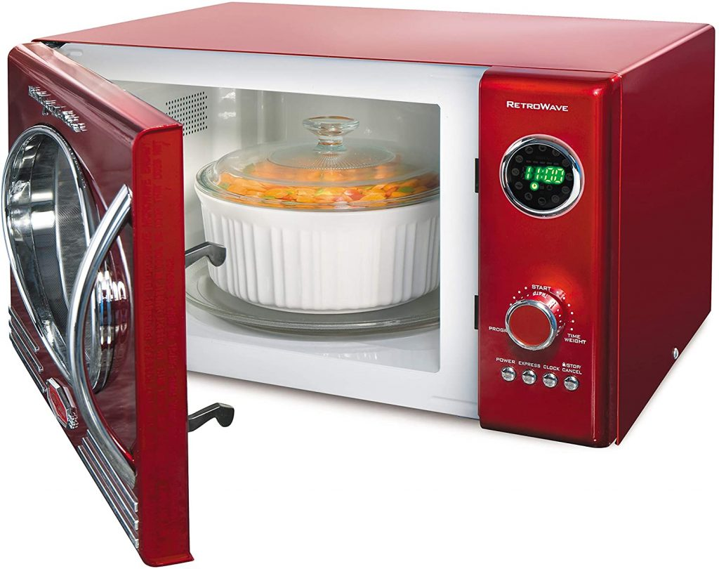 An image showing a red Nostalgia microwave oven with its interior